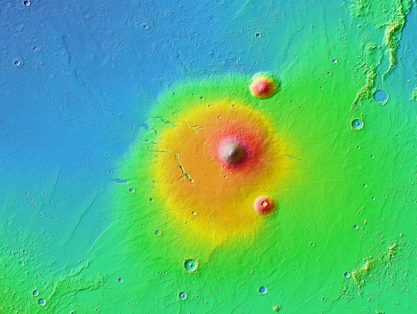 The Elysium volcanic province showing Martian volcanoes with large, low profile bulges, long trenches and distant rills.